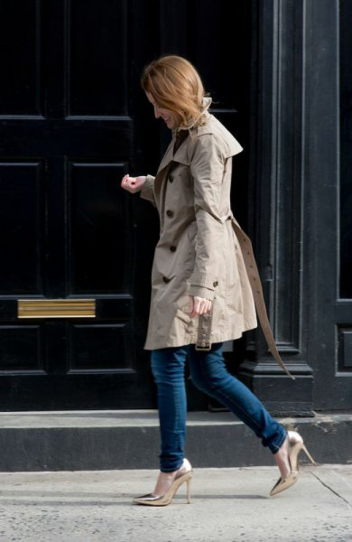 gray longline parka jacket with dark skinny jeans and golden heels