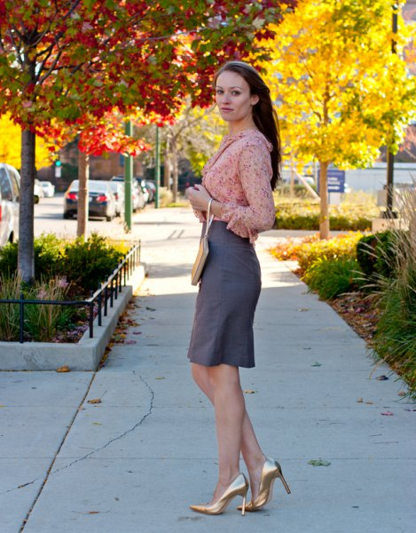 blushing pink chiffon blouse with gray knee length skirt and gold heels