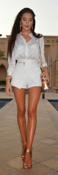 white silk shirt with buttons, mini shorts and gold heels
