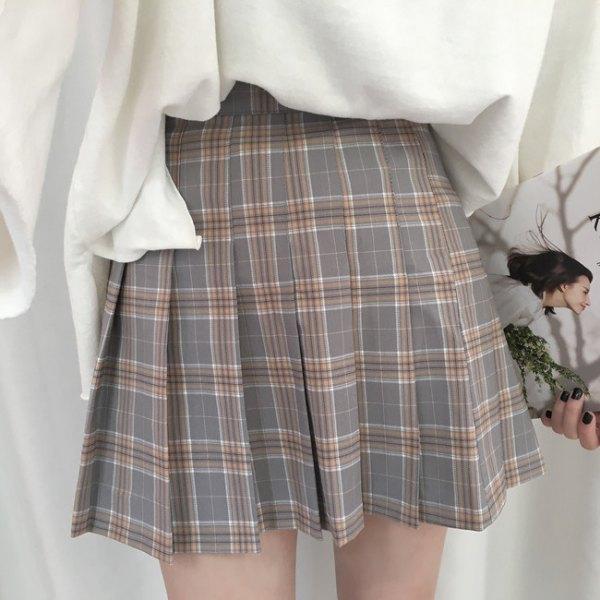 white, chunky sweatshirt with checkered high-rise mini skirt