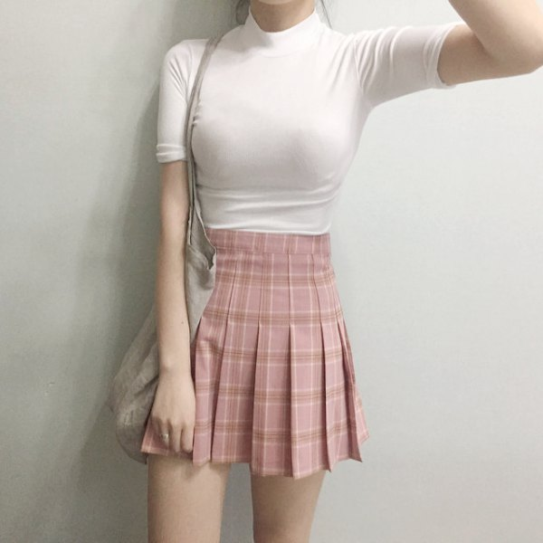 black, form-fitting t-shirt with stand-up collar and pink pleated mini skirt