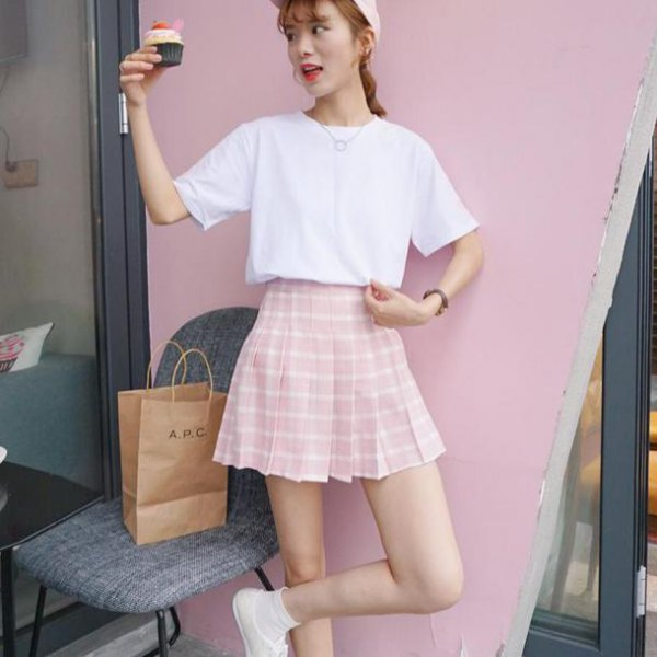 white t-shirt with a relaxed fit and pink and white checkered skater skirt