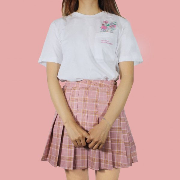 white t-shirt with pink pleated skirt