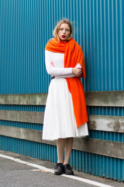 white sweater with matching midi flared skirt and orange long scarf