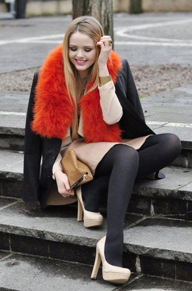 orange faux fur scarf with dark blue wool coat and skirt