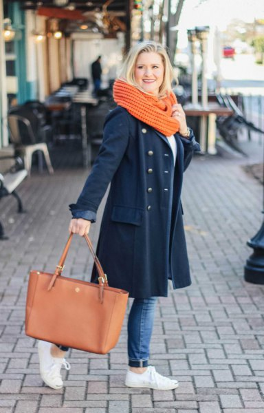 Dark blue longline wool coat with jeans and white sneakers