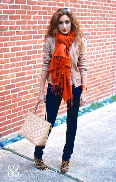 orange fringed scarf, light pink bomber jacket and leopard print boots