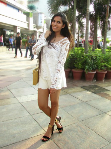 white lace blouse with flowing mini shorts and black and gold sandals