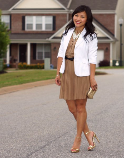 white blazer with blushing pink mini pleated skirt and gold heels