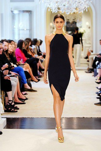 form-fitting mini dress made of black halter neck with gold sandals