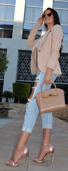 blushing pink blazer with shortened ripped boyfriend jeans