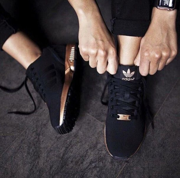 short sweatpants with black and gold running shoes
