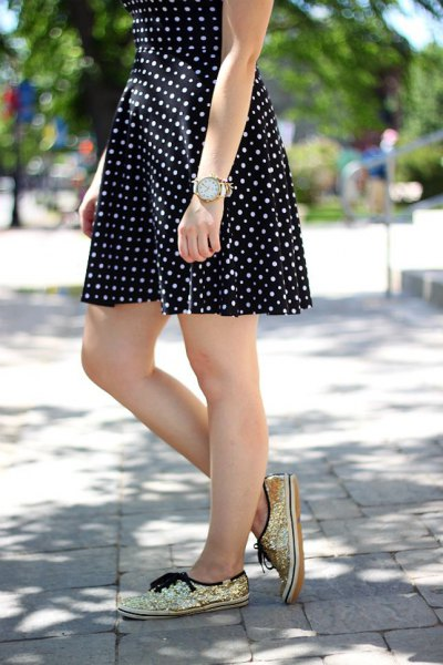 black and white polka dot and flared mini dress with golden sequin sneakers