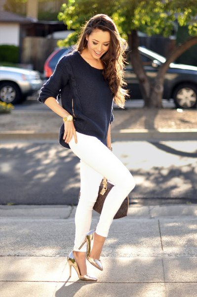 black, loose-fitting sweater with white skinny jeans