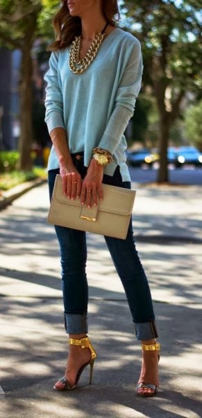 gray sweater with gold chain and matching high heels