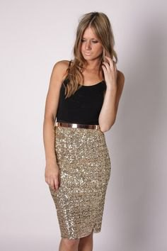 black tank top with scoop neck and knee-length sequin skirt made of gold