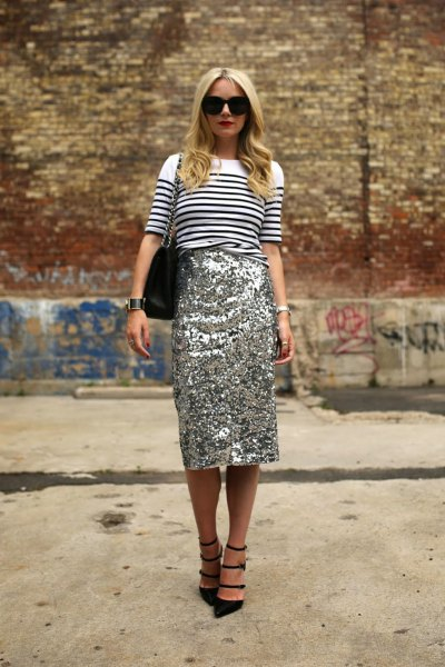 white-black striped knit sweater with gold midi sequin skirt