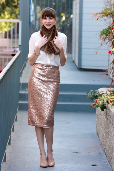 white chiffon blouse with gold midi sequin skirt and faux fur scarf