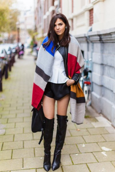 multicolored oversized scarf with black mini shorts and long boots