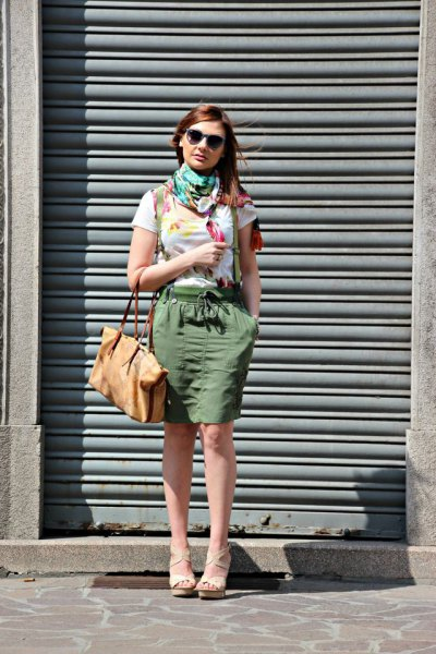 white T-shirt with gray scarf and green knee-length cargo skirt