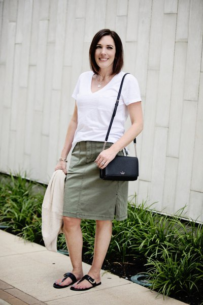 white t-shirt with v-neck and gray knee-length, straight skirt
