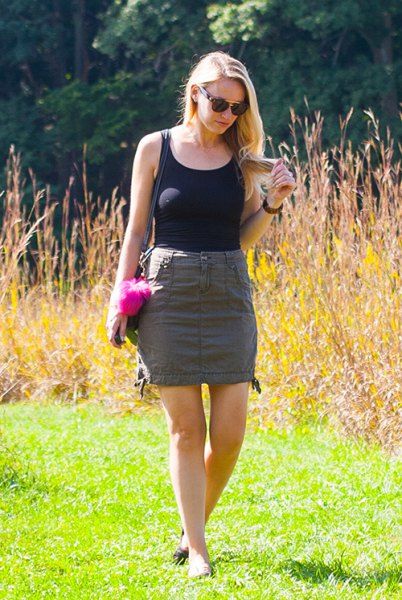 black tank top with scoop neck, gray mini skirt and slip sandals