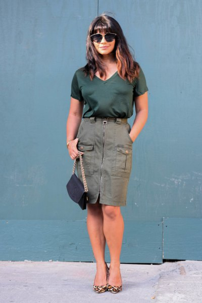 black t-shirt with v-neck and cargo skirt with zip