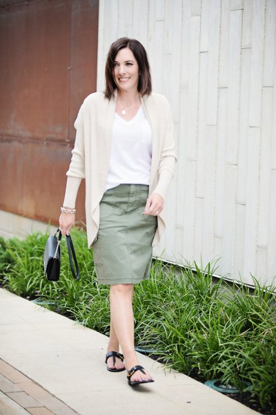 Light pink cardigan with white V-neck t-shirt and knee-length skirt