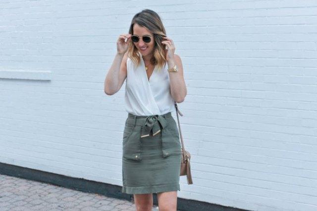white sleeveless wrap top with gray mini skirt