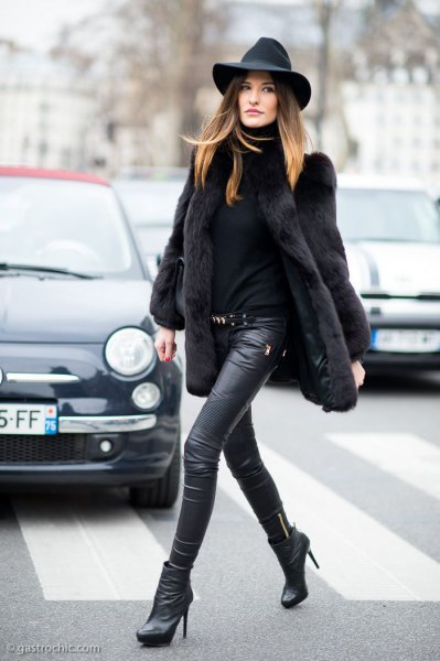black leather hat with faux fur coat and biker leggings