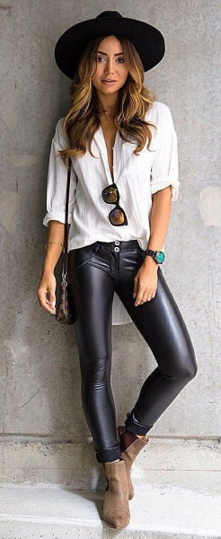 white boyfriend shirt with black hat and leather leggings