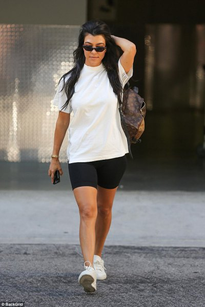 white t-shirt with black biker shorts and sneakers