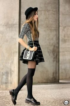 Black and white polka dot blouse with checkered mini skater skirt