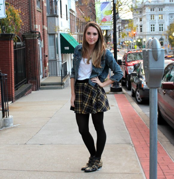 gray denim jacket with black checkered skirt and leggings