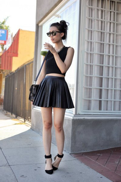 black short tank top with pleated minirater leather skirt