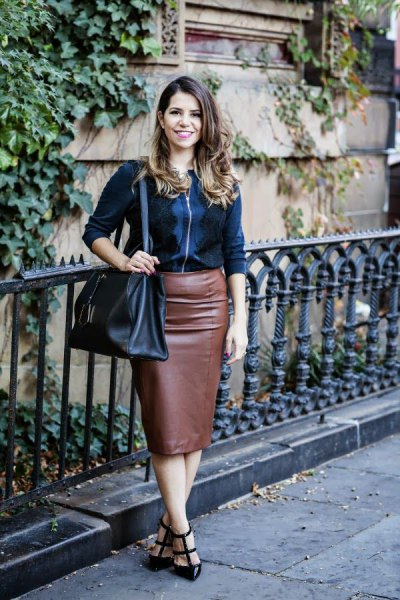 black jacket with zipper and brown midi skirt made of synthetic leather