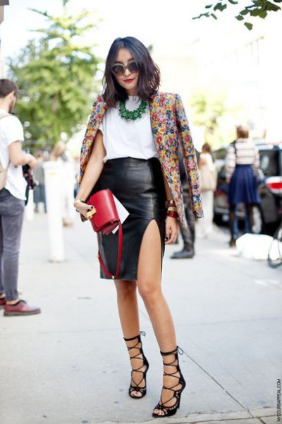 Blazer with floral print and black faux leather skirt with side slits