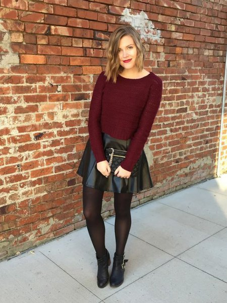 burgundy-colored sweater with black imitation leather skater skirt