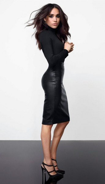 black figure-hugging sweater with knee-length leather skirt