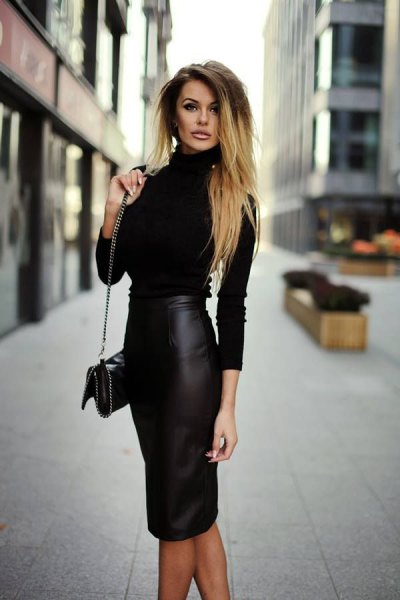 figure-hugging sweater with mock neckline and figure-hugging midi synthetic leather skirt