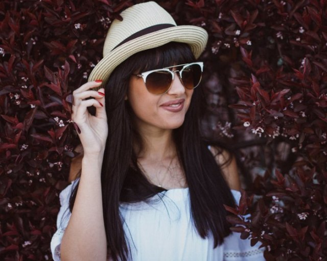 Bush hat with white shoulder blouse