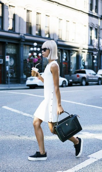 white sleeveless mini dress with black sneakers