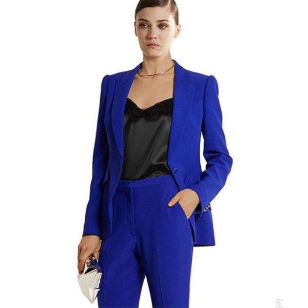 royal blue suit with black, low-cut silk blouse