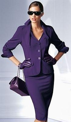 purple skirt suit with black leather handbag