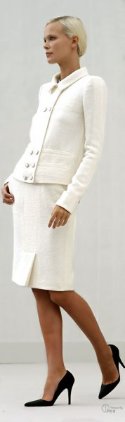 white blazer with matching knee-length skirt and black ballerinas