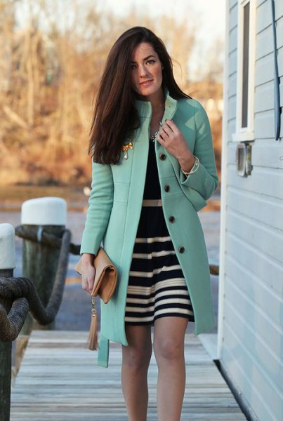 gray long coat with black and white striped mini dress