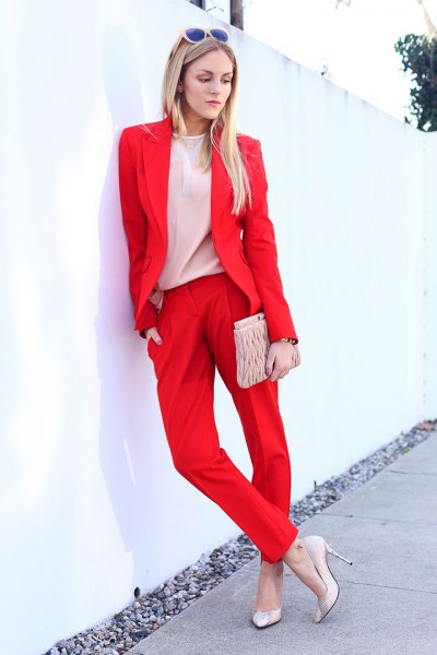 red blazer with light pink chiffon blouse and clutch