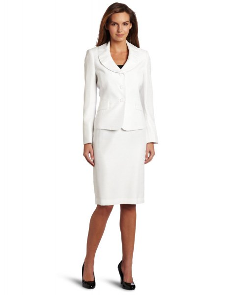 white suite jacket with knee-length, straight cut dress and black heels