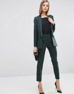 dark green suit with black t-shirt and pointed toe heels