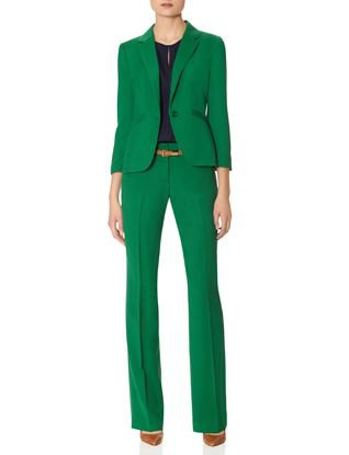 green suit jacket with high-waisted trousers with straight legs